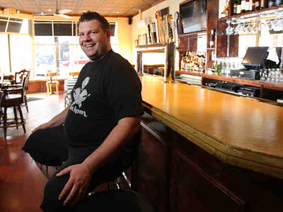 Mike Stollenwerk at the bar of Fathom Seafood House in Fishtown. (MICHAEL BRYANT / Staff Photographer)