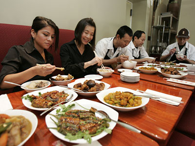 At Hunan in Ardmore, members of the staff - Zulmary Torres, Min Wu, Jiu Lou, Lak Ley, and Savy Kohna - eat together three times a day. Staff meals at other local eateries vary: New menu items may be tested, young chefs may show off their skills, dining-room leftovers may be dressed up and served anew. (DAVID SWANSON / Staff Photographer)