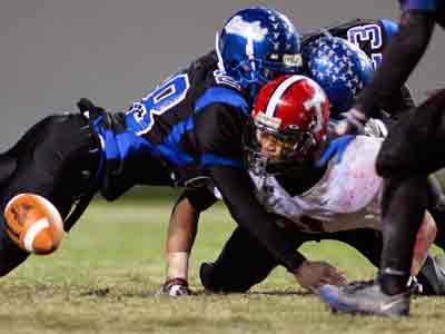 The risk of concussions on the football field has become a major issue at both the youth and professional levels. Researchers and physicians fear they can lead to long-lasting brain damage. (AP Photo/Karl B DeBlaker)