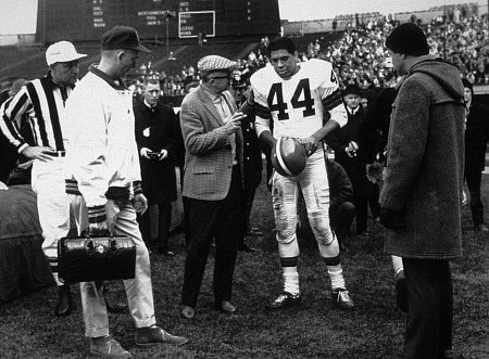 "That´s Ron Rich as the football hero, being coached by director Billy Wilder. To the right in the duffel coat is Jack Lemmon as the sports cameraman in ""The Fortune Cookie."""