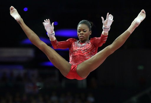U.S. gymnast Gabrielle Douglas perfroms on the uneven bars during the Artistic Gymnastics women´s team final at the 2012 Summer Olympics, Tuesday, July 31, 2012, in London. (AP Photo/Julie Jacobson)