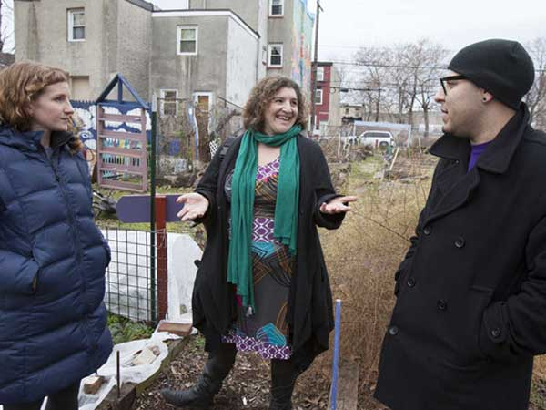 Ginny Smith writes about Las Parcelas, a community garden that´s part of the Norris Square Project, 2240 N. 2nd Street. Attorney Amy Laura Cahn, center talks with Interim Executive Director Megan Barnes, left and Director of Garden Programs Rafael Alvarez, right.( Ed Hille / Staff Photographer )