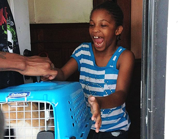 A cat is reunited with family members nearly a month after the pet went missing during a fatal fire on the 6500 block of Gesner Street in Southwest Philadelphia.