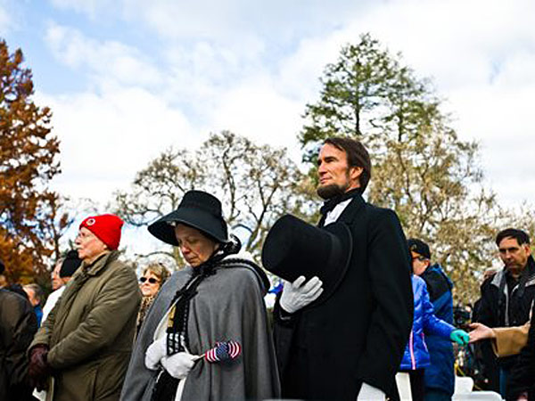 Re-enactors John Voehl and his wife, Pamela Voehl, portray President Lincoln and Mary Todd Lincoln as they listen to the benediction during the 150th Anniversary of the Gettysburg Address on Tuesday, Nov. 19, 2013 in Soldiers´ National Cemetery in Gettysburg, Pa. (AP Photo/The Evening Sun, Clare Becker)