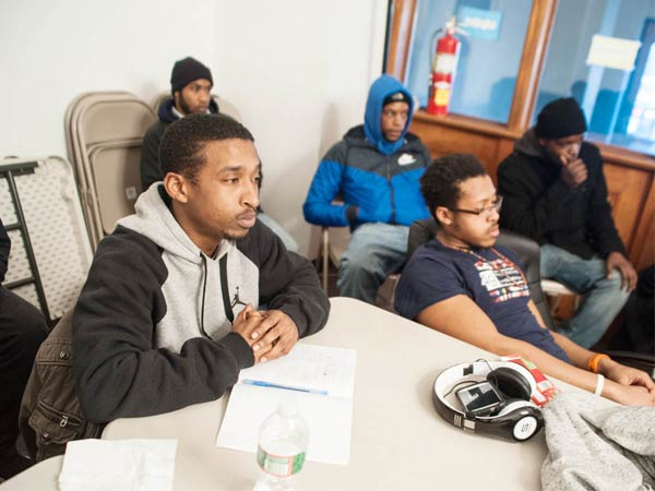 Christopher Gilbert, a teen father, listens to a group discussion during an active parenting workshop hosted by the Institute for the Development of African American Families. Wednesday, February 26, 2014, Philadelphia, Pennsylvania. ( Matthew Hall / Staff Photographer )