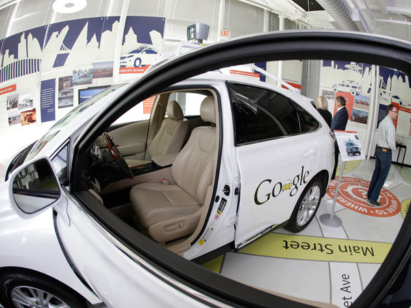 A Google self-driving car is shown in an exhibit at the Computer History Museum in Mountain View, Calif. Four years ago, the Google team developing cars which can drive themselves became convinced that, sooner than later, the technology would be ready for the masses. (AP Photo/Eric Risberg)
