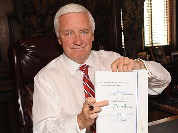 Gov. Corbett gave his John Hancock to the state budget yesterday. He´s using millions to work on pension reform, an issue state voters say isn´t a crisis, poll shows. BRADLEY C. BOWER / ASSOCIATED PRESS