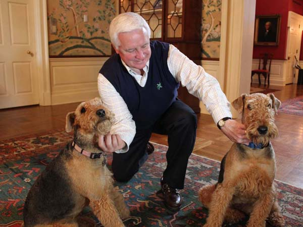 Pennsylvania Governor Tom Corbett pets Harry and Penny, his Airedale Terriers.