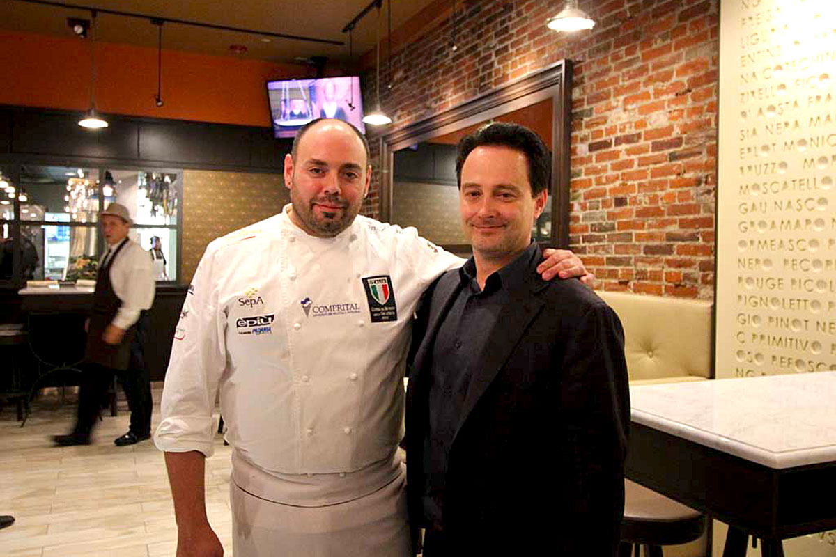 Stefano Biasini (left) with business partner Riccardo Longo at Gran Caffe L´Aquila.