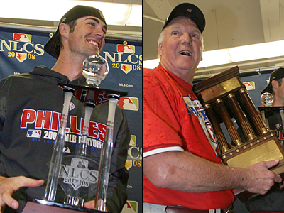 Cole Hamels holds the MVP trophy (left). Charlie Manuel holds the National League trophy.  ( Yong Kim / Staff Photographer )
