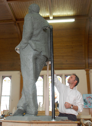 Sculptor Lawrence Nowlan working on a statue of legendary Phillies broadcaster Harry Kalas. If donations raise about $80,000, the clay version will be duplicated in bronze and given to the Phillies for display at Citizens Bank Park.