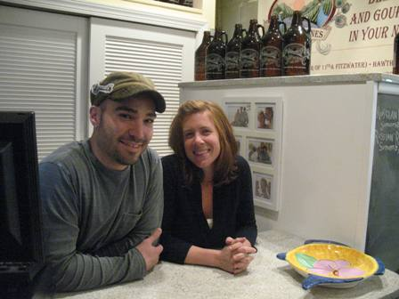 Chris Fetfatzes and Heather Annechiarico behind the counter that hides their secret growler-filler.