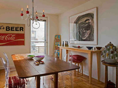 The dining room of Fiammenghi´s home near the Art Museum features a charcoal by local artist Carol Moore and a sign salvaged from a Fairmount Avenue beverage store. (Akira Suwa / Staff Photographer)