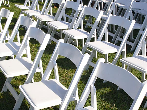 Rows of chairs for the guests at a wedding ceremony. This week&acute;s Ask Jennifer column answers a question about hosting the ceremony in your own backyard. (Photo by iStockphoto.com)<br />