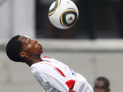 Bertrand Vilgrain of Haiti heads the ball during the soccer match against Bolivia at the Youth Olympics Monday, Aug. 16, 2010 in Singapore. (AP Photo/Wong Maye-E)
