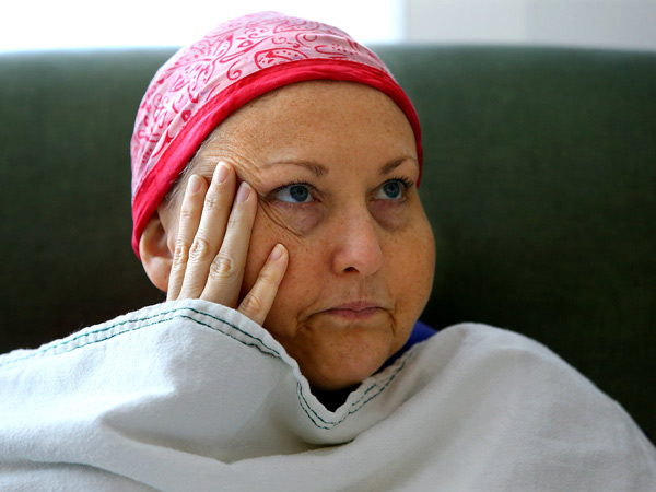 Beth Brock, who has ovarian cancer, waits in a patient room at the Northside Hospital Infusion Center to have her blood tested and a chemotherapy treatment, June 10, 2014, in Atlanta. (Curtis Compton/Atlanta Journal-Constitution/MCT)