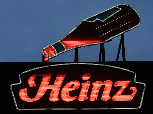 An animated neon Heinz Ketchup bottle that was once on the company´s North Side factory in Pittsburgh, now sits atop the Senator John Heinz History Center in Pittsburgh, Thursday, Feb. 14, 2013.  Billionaire investor Warren Buffettís Berkshire Hathaway and its partner on the deal, 3G Capital, is dipping into the ketchup business as part of a $23.3 billion deal to buy the Heinz ketchup company. (AP Photo/Gene J. Puskar)
