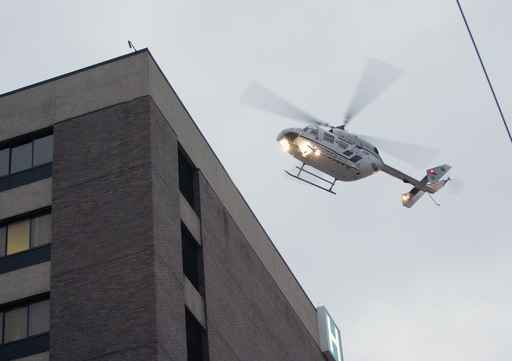A helicopter lands on the roof of the Cooper University Hospital. (Michael Bryant/Inquirer)