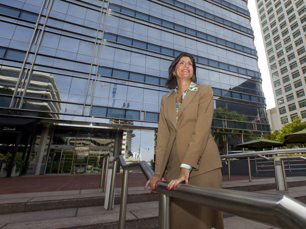 Mary Jo Eaton, executive managing director of CBRE, in front of the 777 Brickell Building, one of the properties the firm manages and where its Miami office is located. Eaton has taken big risks to help CBRE expand in Florida, most recently opening a Tallahassee office. (CW Griffin/Miami Herald/MCT)