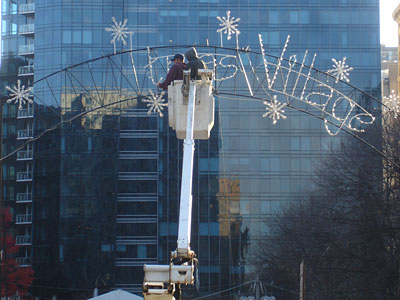 "Crews remove the word ""Christmas"" from the sign at Dilworth Plaza. (VANCE LEHMKUHL / Staff)"