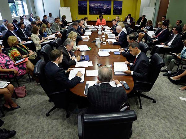 Camden Mayor Dana Redd, left, listens during a meeting of the New Jersey Economic Development Authority Thursday, July 10, 2014, in Trenton, N.J., where a vote was taken on a $260 million tax break over 10 years for a manufacturing firm that wants to do business in Camden. AP/ Mel Evans