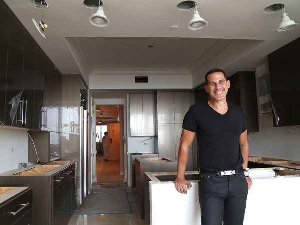 Interior designer Joe Fava survived the slowdown in the South Florida real estate market by traveling to other states to find work. But now that things are recovering, he is staying closer to home. He is shown at a home in Boca Raton, Fla., on Oct. 16, 2013. (Carline Jean/Sun Sentinel/MCT)