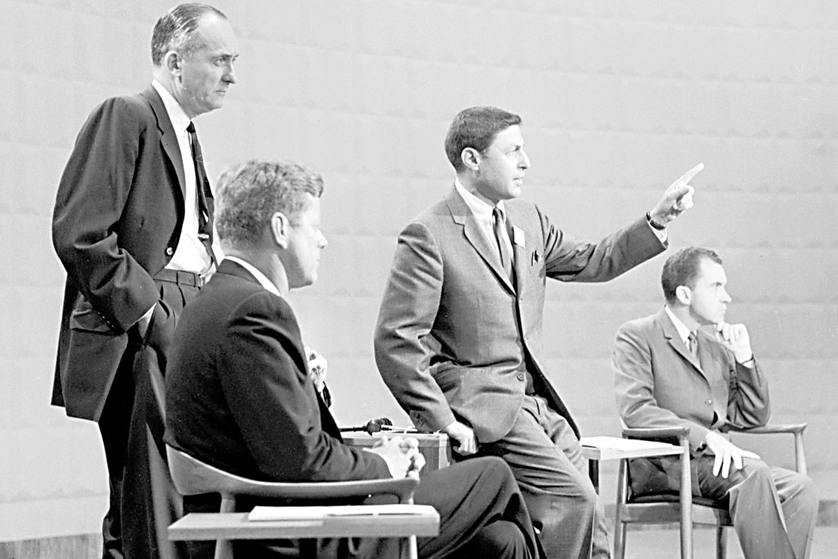 """Sen. John F. Kennedy, second from left, CBS´ Don Hewitt, second from right, and Vice President Richard M. Nixon, right, take part in the presidential debate in this Sept. 25, 1960 photo courtesy of the CBS photo archive. Man at far left is unidentified. At age 81, Hewitt has agreed to step down from his current role at """"60 Minutes"""" and accept a new job created for him whose duties are yet to be determined. A hour long broadcast on Hewitt, """"Tell Me a Story: The Man Who Made ´60 Minutes,´"""" airs Tuesday, May 18, 2004 at 9 p.m. EDT on CBS."""