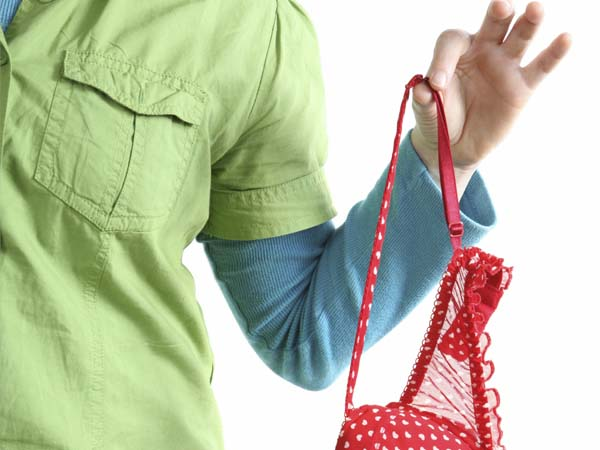 woman holding a bra