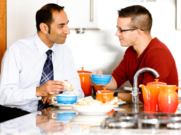 A gay couple enjoying breakfast.