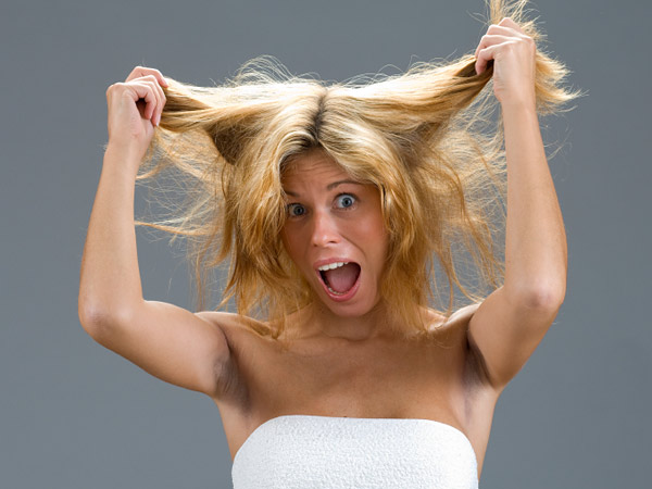 Family pressure to leave her hairdresser makes her want to pull her hair out. (iStock photo)