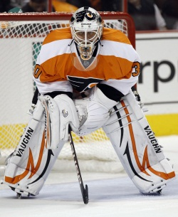 Flyers&acute; goalie Ilya Bryzgalov (who in his last four games -- all losses -- has a 5.05 GAA and .802 save percentage) is looking to get back on track against the Carolina Hurricanes on Saturday night.  (YONG KIM / Staff<br />Photographer)