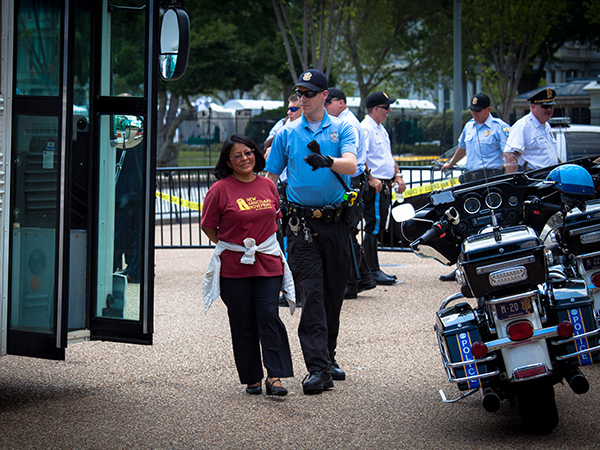 Activist Carmen Guerrero, of Norristown, is led away by police during an immigration reform rally outside the White House July 31, 2014.