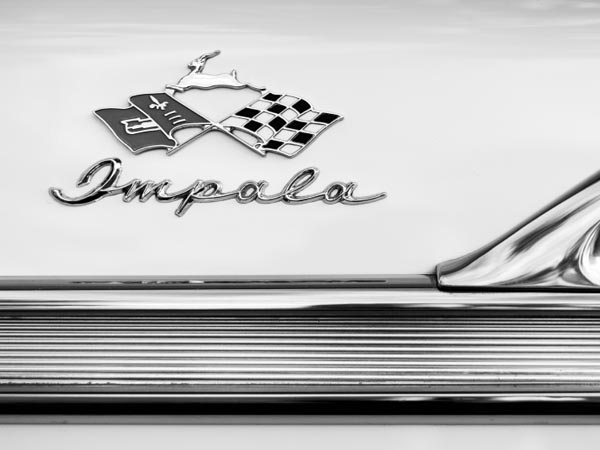 Classic Chevrolet Impala emblem in black and white.