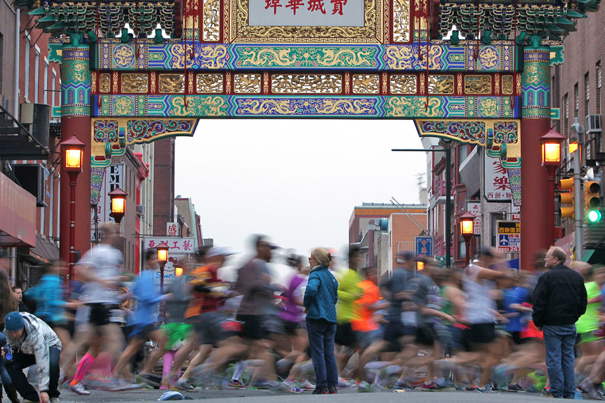 Watch for runners: Competitors pass the Arch in Chinatown during the 2013 Philadelphia Marathon.  This year, for the 23rd year of the race, the half marathon and 8K are on Saturday, along with a kids´ run, while the full marathon is on Sunday.