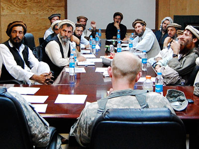 "Village elders and troops from the U.S. Provincial Reconstruction Team meet for a ""shura,"" or consultative council, at Forward Operating Base Kala Gush in Nuristan."