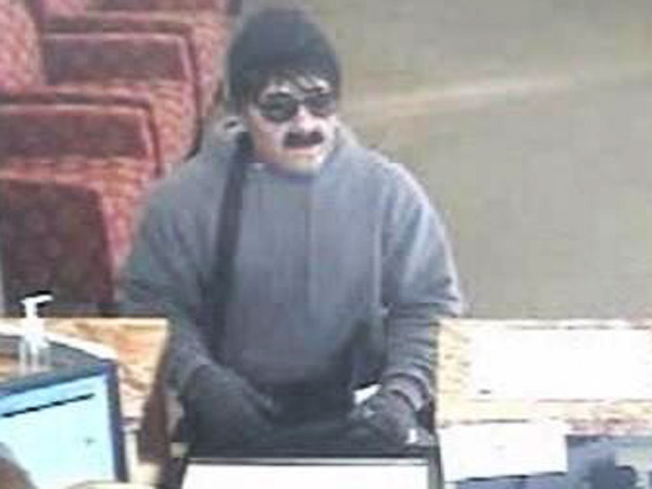"The ""Inspector Clouseau bandit"" at work at a Wells Fargo Bank branch in Wilmington."