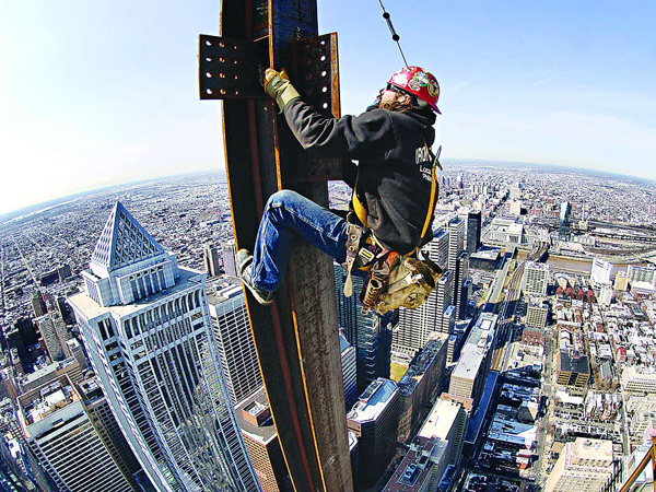 FILE: Ironworker Mike Kulp climbs a column before connecting a beam to the 54th floor of the 58-story Comcast Center. Work began in 2005 for a 2008 opening.