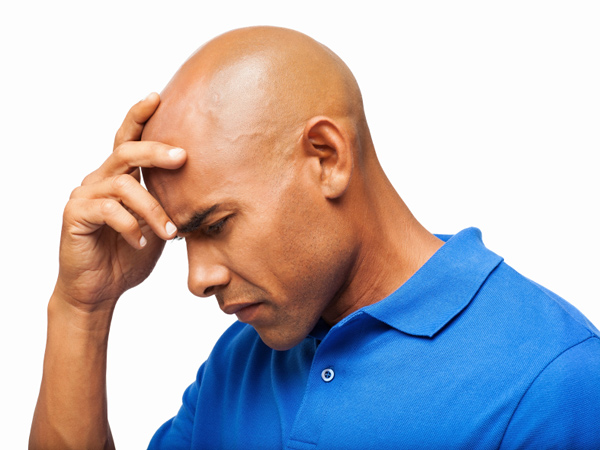 Black men with early hair loss may have a heightened risk of developing prostate cancer, researchers report. (istockphoto.com)