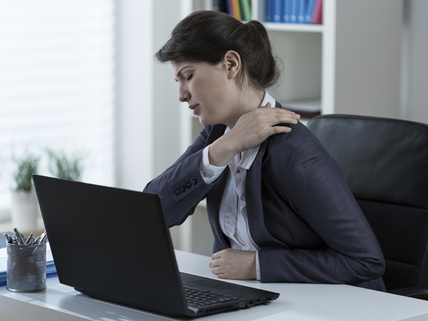 Sitting all day at work can be a real pain in the back. (istockphoto.com)