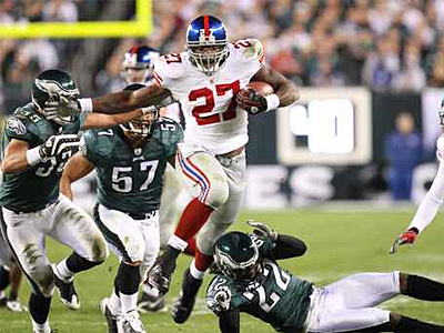 Giants running back Brandon Jacobs hurdles Asante Samuel in the first quarter as the Philadelphia Eagles take on the New York Giants at Lincoln Financial Field in Philadelphia, PA on November 9, 2008. ( Steven M. Falk / Staff Photographer )