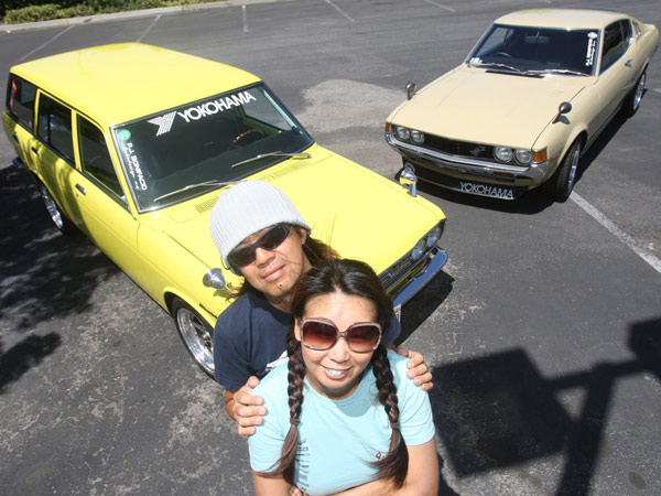 Terry and Koji Yamaguchi with two of their classic cars on May 14, 2014, in La Mirada, Calif. (Gary Friedman/Los Angeles Times/MCT)