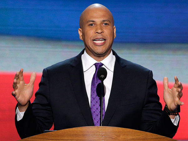 """In this Sept. 4, 2012, file photo, Newark, N.J., Mayor Cory Booker addresses the Democratic National Convention in Charlotte, N.C. In a 1992 column in The Stanford Daily, his college newspaper, Booker wrote that he was """"disgusted by gays"""" before a transformative experience with a gay peer counselor changed his views. (AP Photo/J. Scott Applewhite, File)"""