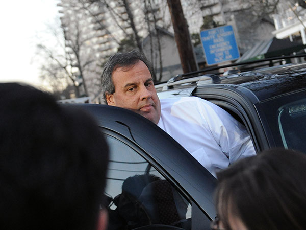New Jersey Gov. Chris Christie leaves after a Jan. 9, 2014 visit  to Fort Lee, N.J. Christie traveled to Fort Lee to apologize in person to Mayor Mark Sokolich. (AP Photo/ Louis Lanzano)