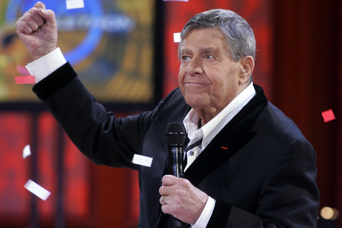 In this Sept. 1, 2008 file photo, Jerry Lewis listens to the final tally of donations during the 43rd annual Muscular Dystrophy Association Labor Day Telethon.<br />