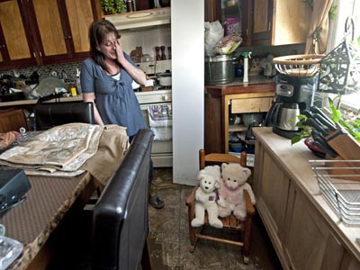 The Jersey shore two weeks after Hurricane Sandy on Nov. 12, 2012.  Here, Sherry Onder in her Seaside Heights home; the two teddy bears that her granddaughter Miley Ryan Roberts loves were almost the only things that didn´t get soaked and ruined in the storm. (April Saul/Staff)