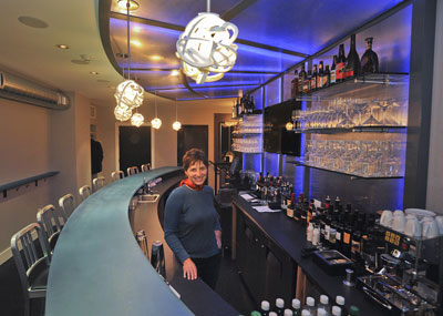 Jill Weber behind the street-level bar at Jet Wine Bar. (Photo: Sharon Gekoski-Kimmel / Staff)