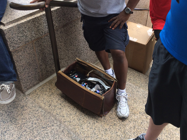 Gift-shop bags containing boxed gold JFK coins were collected in a box by one group´s private security force outside the mint on the afternoon of Aug. 5, 2014.