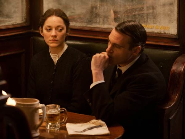 "This photo released by the Weinstein Company shows Marion Cotillard, left, and Joaquin Phoenix, in a scene from the film, ""The Immigrant."" The movie opens in the U.S. with a limited release on May 16, 2014."