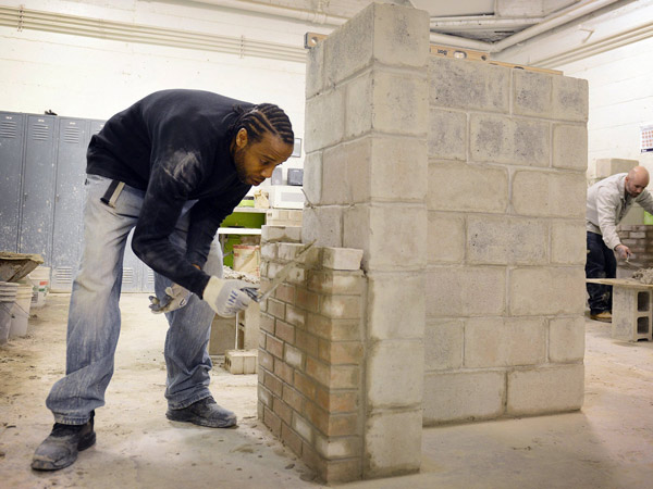 "Ryan Kelley, 35, builds a ""z wall"" on March 12, 2014, at the Trade Institute of Pittsburgh in Wilkinsburg, Pa. Kelley said he enjoys the work and is excited for the opportunity to enter the job market and earn a decent wage. (Julia Rendleman/Pittsburgh Post-Gazette/MCT)"