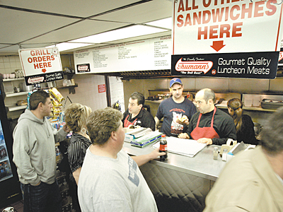 Customers line up to place their orders at John´s Roast Pork at 14 E. Snyder Ave in Philadelphia. John Bucci Jr. (dark hair) takes an order. (Laurence Kesterson / Inquirer)